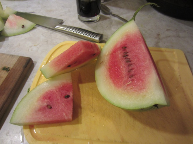 Our first (pink) watermelon. It's hard to know when they're ready, and melons left in the garden too long invariably get devoured by the hungry Chunky family.