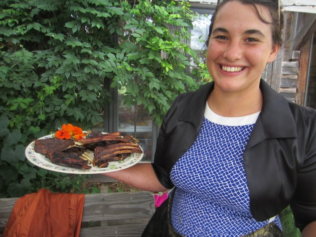The head chef grinning ear to ear with her main course in hand.
