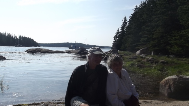 Mom and Dad and their boat in the background